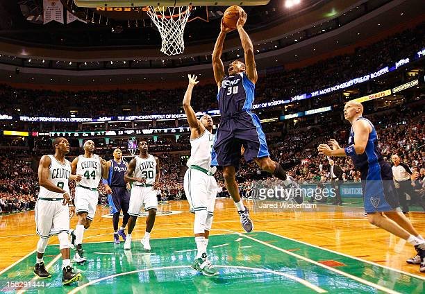 Dahntay Jones of the Dallas Mavericks goes up to dunk the ball in front of Paul Pierce of the Boston Celtics during the game on December 12 2012 at...