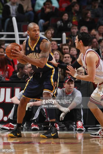 Dahntay Jones of the Indiana Pacers handles the ball against Kirk Hinrich of the Chicago Bulls during the game on December 29 2009 at the United...
