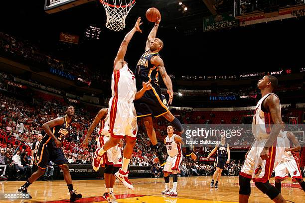 Dahntay Jones of the Indiana Pacers shoots against Jamaal Magloire of the Miami Heat on January 19 2010 at American Airlines Arena in Miami Florida...