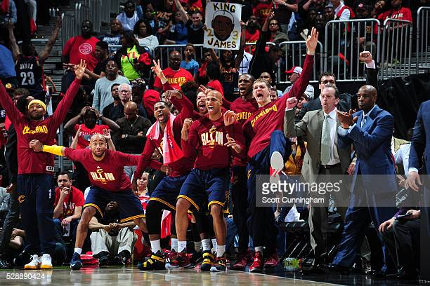 Dahntay Jones Tristan Thompson Richard Jefferson James Jones and Timofey Mozgov of the Cleveland Cavaliers celebrates from the bench during the game...