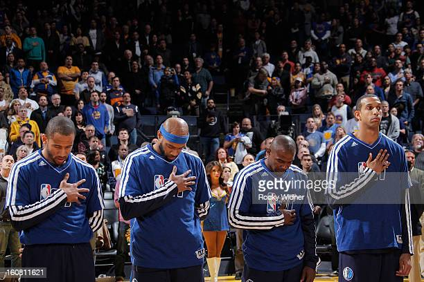 Dahntay Jones Vince Carter Mike James and Brandan Wright of the Dallas Mavericks during the national anthem in a game against the Golden State...