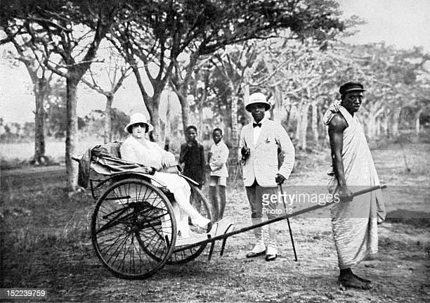 Dahomey A civil servant in Bordeaux Prince Arini Oualino son of former King Behanzin on a stroll with his young wife during a stay in Abomey