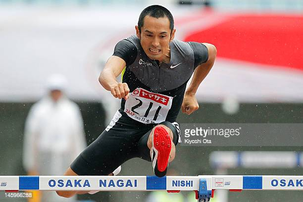Dai Tamesue of Japan competes in the Men's 400m Hurdles heat during day one of the 96th Japan National Championships at Nagai Stadium on June 8, 2012...