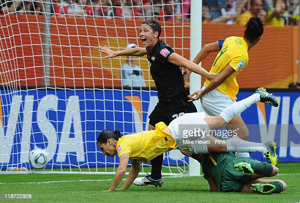 Daiane of Brazil deflects the ball past her own goalkeeper Andreia as Abby Wambach of USA celebrates during the FIFA Women's World Cup 2011 Quarter...