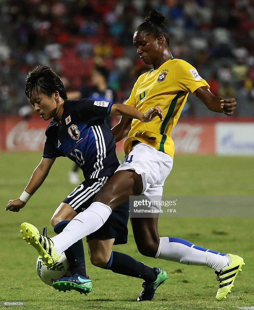 Daiane of Brazil tackles Yuka Momiki of Japan during the FIFA U-20 Women's World Cup Papua New Guinea 2016 Quarter Final match between Japan and Brazil at the National Footbal Stadium on November 24, 2016 in Port Moresby, Papua New Guinea.