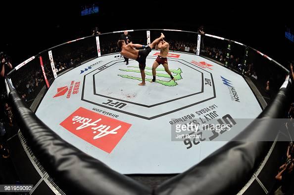 Daichi Abe Of Japan Kicks Li Jingliang Of China In Their