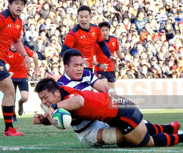 Daichi Akiyama of Teikyo grounds the ball to score his side's second try during the 54th All Japan University Rugby Championship Final at Teikyo and...