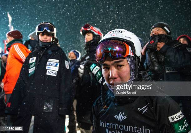 Daichi Hara of Japan after finishing in third place kneels in the finish area before the medal presentation ceremony after the Men's Dual Moguls...
