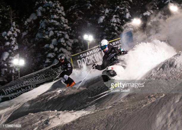 Daichi Hara of Japan races Bradley Wilson of the United States during the semifinal of the Men's Dual Moguls Final of the FIS Freestyle Ski World...