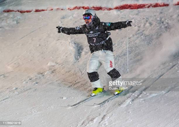 Daichi Hara of Japan reacts after crossing the finish line during the small final on his way to finishing in third place in the Men's Dual Moguls...