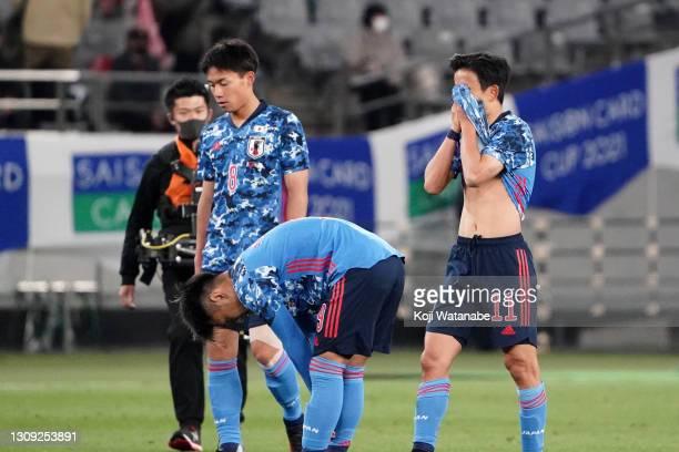Daichi Hayashi, Ryotaro Meshino and Takefusa Kubo of Japan show dejection after their 0-1 defeat in the U-24 international friendly match between...