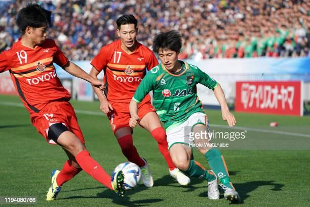 Daichi Ichimaru of Nagoya Grampus and Riku Furuyado of Aomori Yamada compete for the ball during the Prince Takamado Trophy JFA U-18 Football Premier...