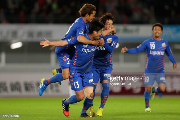 Daichi Inui of V-Varen Nagasaki celebrates scoring the opening goal with his team mates during the J.League J2 match between V-Varen Nagasaki and...