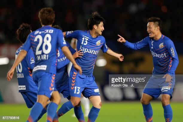 Daichi Inui of VVaren Nagasaki celebrates scoring the opening goal with his team mates during the JLeague J2 match between VVaren Nagasaki and...