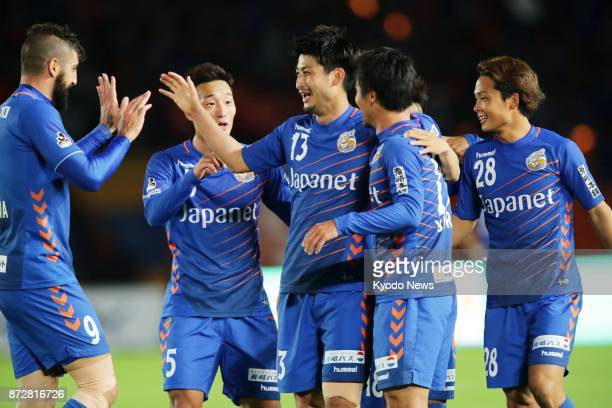Daichi Inui of VVaren Nagasaki is congratulated by teammates after opening the scoring during the first half of their 31 win at home over Kamatamare...