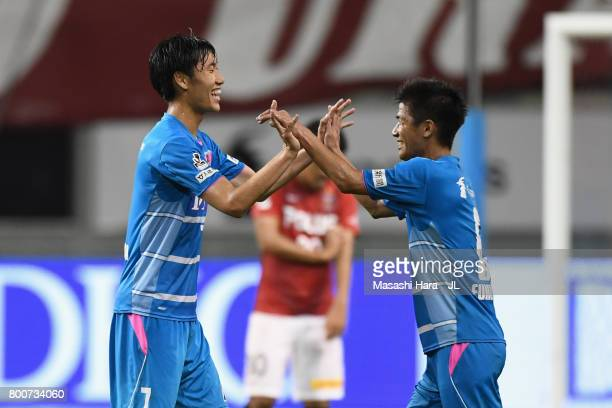 Daichi Kamada and Akito Fukuta of Sagan Tosu celebrate their 21 victory after the JLeague J1 match between Sagan Tosu and Urawa Red Diamonds at Best...