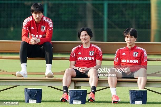 Daichi Kamada and Takumi Minamino and Genki Haraguchi of Japan look on during the Japan training session on June 08, 2021 in Suita, Osaka, Japan.