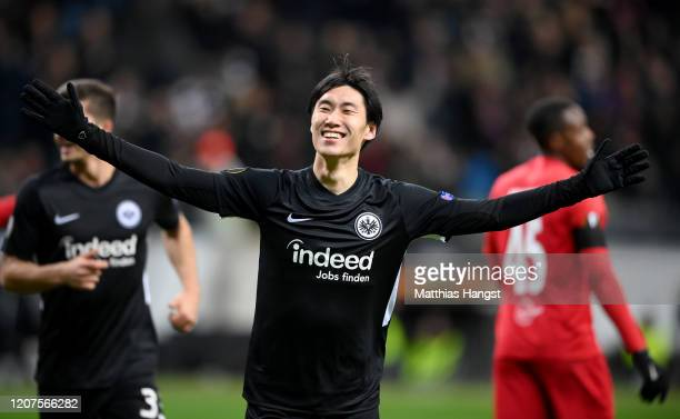 Daichi Kamada of Eintracht Frankfurt celebrates after scoring his team's third goal during the UEFA Europa League round of 32 first leg match between...