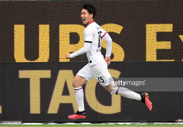 Daichi Kamada of Eintracht Frankfurt celebrates after scoring his team's second goal during the Bundesliga match between VfL Wolfsburg and Eintracht...