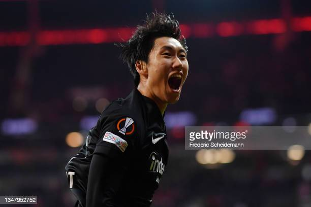 Daichi Kamada of Eintracht Frankfurt celebrates after scoring their sides third goal during the UEFA Europa League group D match between Eintracht...