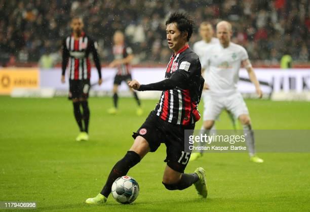 Daichi Kamada of Eintracht Frankfurt controls the ball during the Bundesliga match between Eintracht Frankfurt and SV Werder Bremen at...