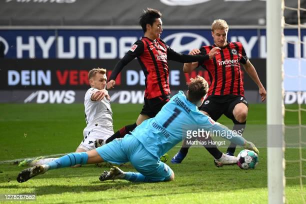 Daichi Kamada of Eintracht Frankfurt scores his team's first goal past Oliver Baumann of TSG 1899 Hoffenheim during the Bundesliga match between...