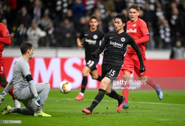 Daichi Kamada of Eintracht Frankfurt scores his team's second goal during the UEFA Europa League round of 32 first leg match between Eintracht...
