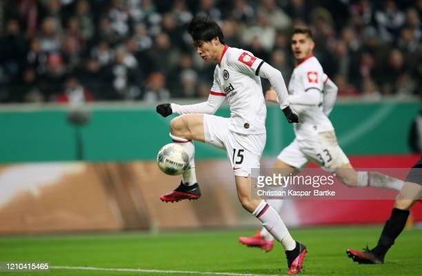 Daichi Kamada of Eintracht Frankfurt scores his teams second goal during the DFB Cup quarterfinal match between Eintracht Frankfurt and Werder Bremen...