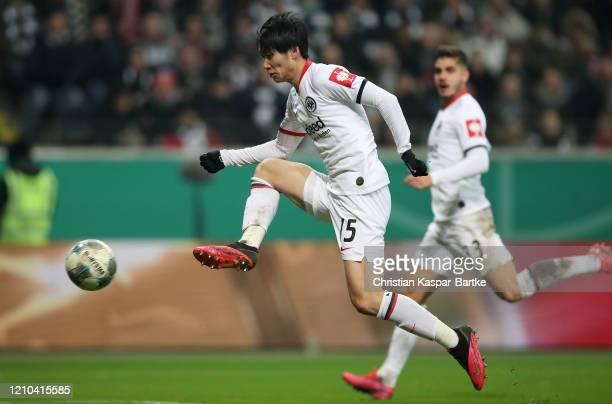 Daichi Kamada of Eintracht Frankfurt scores his team's second goal during the DFB Cup quarterfinal match between Eintracht Frankfurt and Werder...