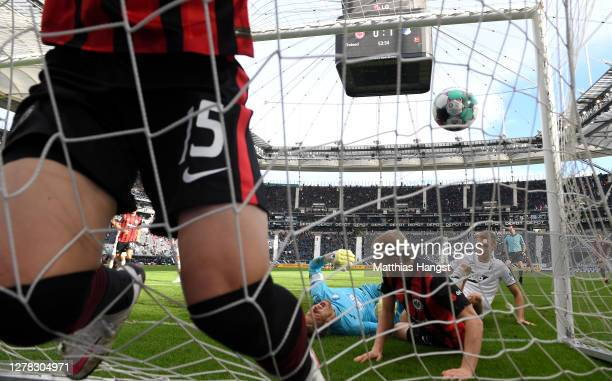 Daichi Kamada of Frankfurt scores his team's first goal past Goalkeeper Oliver Baumann of Hoffenheim during the Bundesliga match between Eintracht...