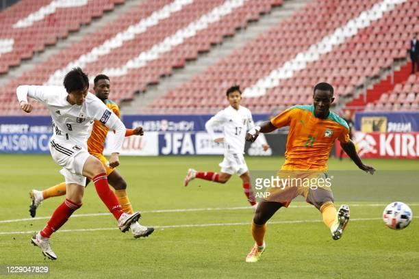 Daichi Kamada of Japan, Eric Bailly of Ivory Coast during the friendly match between Japan and Ivory Coast at Stadium Galgenwaard on October 13, 2020...