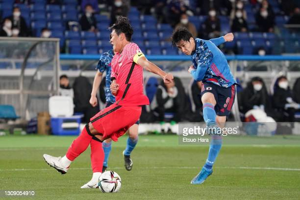 Daichi Kamada of Japan scores his side's second goal during the international friendly match between Japan and South Korea at the Nissan Stadium on...