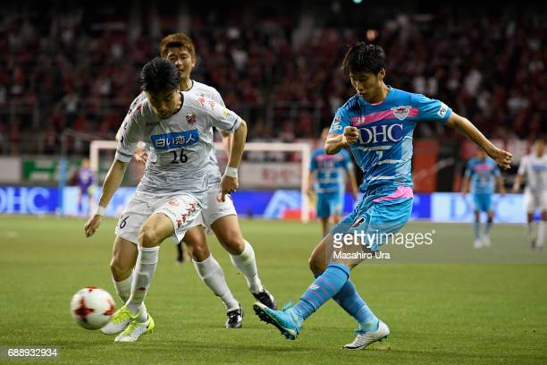Daichi Kamada of Sagan Tosu and Ryota Hayasaka of Consadole Sapporo compete for the ball during the JLeague J1 match between Sagan Tosu and Consadole...