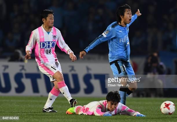 Daichi Kamada of Sagan Tosu is fouled by Kengo Nakamura of Kawasaki Frontale during the JLeague J1 match between Kawasaki Frontale and Sagan Tosu at...