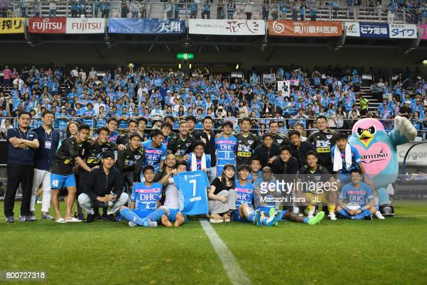 Daichi Kamada of Sagan Tosu poses with his team mates after a sending off ceremony as he joins Eintracht Frankfurt after the JLeague J1 match between...