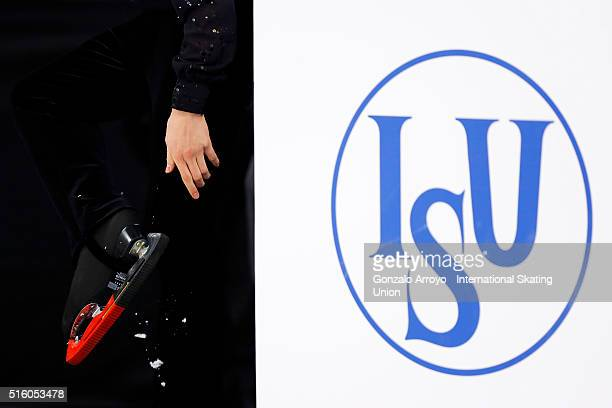 Daichi Miyata from Japan covers his skate's blades after his show during the male's short program of the ISU World Junior Figure Skating...