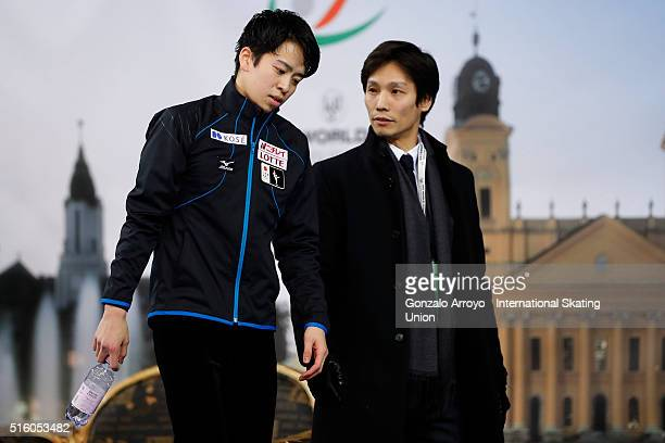 Daichi Miyata from Japan speaks with his coach after his show during the male's short program of the ISU World Junior Figure Skating Championships...