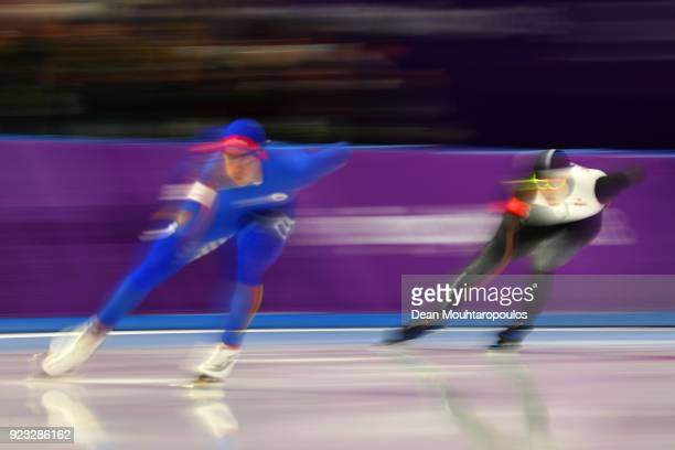 Daichi Yamanaka of Japan and Pedro Causil of Colombia compete during the Men's 1000m on day 14 of the PyeongChang 2018 Winter Olympic Games at...