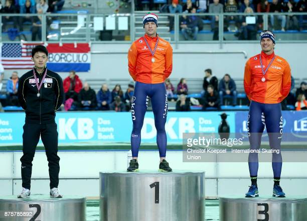 Daichi Yamanaka of Japan poses during the medal ceremony after winning the 2nd place Ronald Mulder of the Netherlands poses during the medal ceremony...