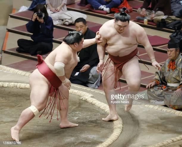 Daieisho defeats Takanosho on the seventh day of the New Year Grand Sumo Tournament at Ryogoku Kokugikan in Tokyo on Jan. 16, 2021.