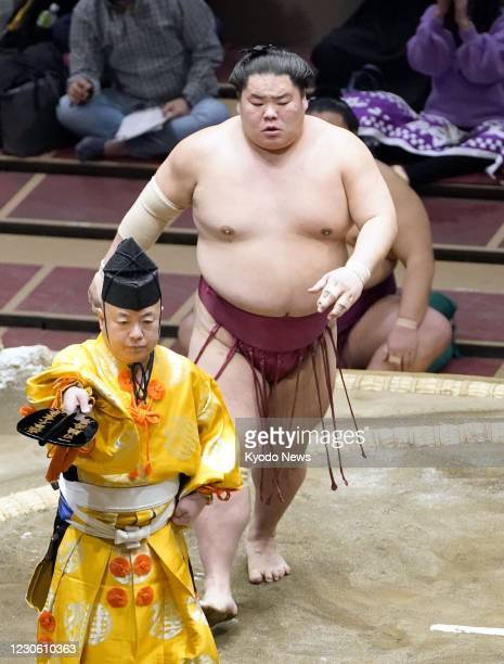 Daieisho reacts after taking sole possession of the lead with a win over Takanosho on the seventh day of the New Year Grand Sumo Tournament at...