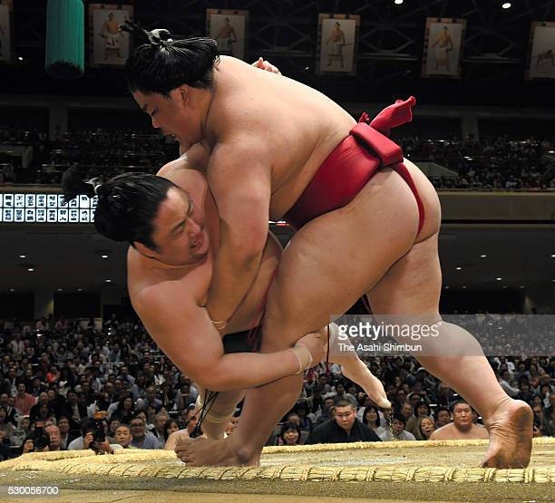 Daieisho throws Sadanoumi to win during day two of the Grand Sumo Summer Tournament at Ryogoku Kokugikan on May 9 2016 in Tokyo Japan