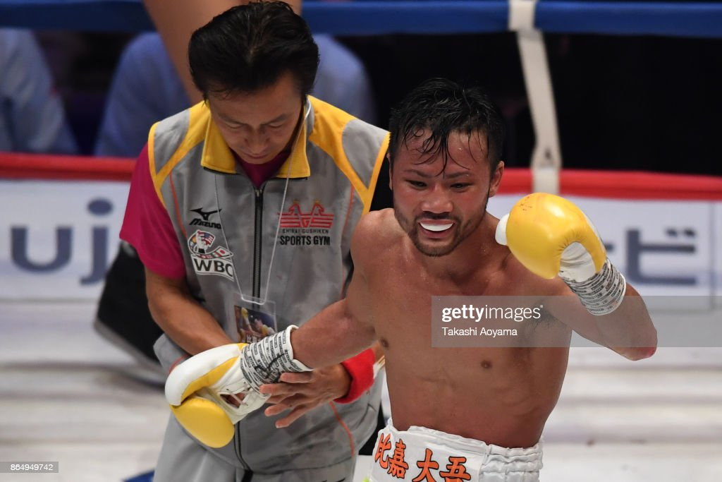 Daigo Higa (R) of Japan celebrates his win over Thomas Masson of France during their WBC flyweight title bout at Ryogoku Kokugikan on October 22, 2017 in Tokyo, Japan.
