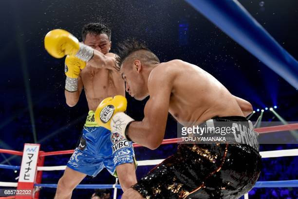 Daigo Higa of Japan lands a punch on Juan Hernandez of Mexico during the sixth round of their WBC flyweight title title bout in Tokyo on May 20 2017...