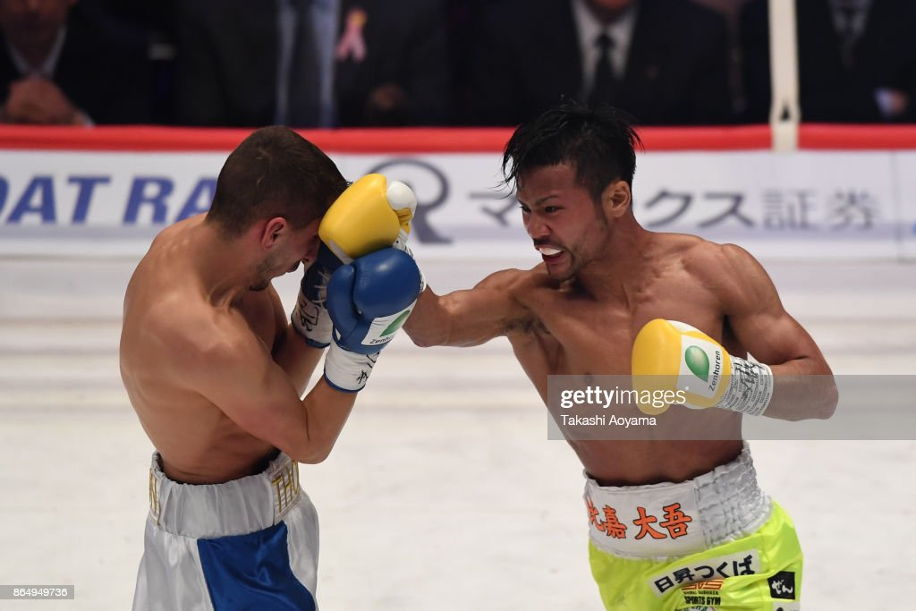 Daigo Higa of Japan (R) punches Thomas Masson of France (L) during their WBC flyweight title bout at Ryogoku Kokugikan on October 22, 2017 in Tokyo, Japan.