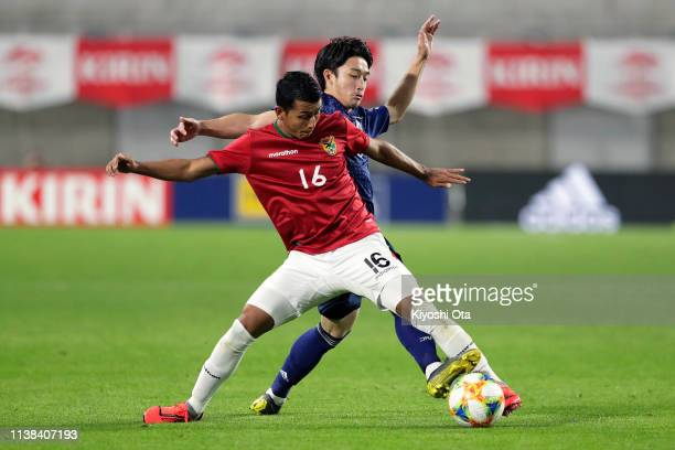 Daigo Nishi of Japan and Roberto Fernandez of Bolivia during the international friendly match between Japan and Bolivia at Noevir Stadium Kobe on...