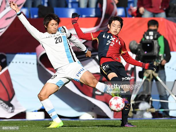 Daigo Nishi of Kashima Antlers and Shintaro Kurumaya of Kawasaki Frontale compete for the ball during the 96th Emperor's Cup final match between...