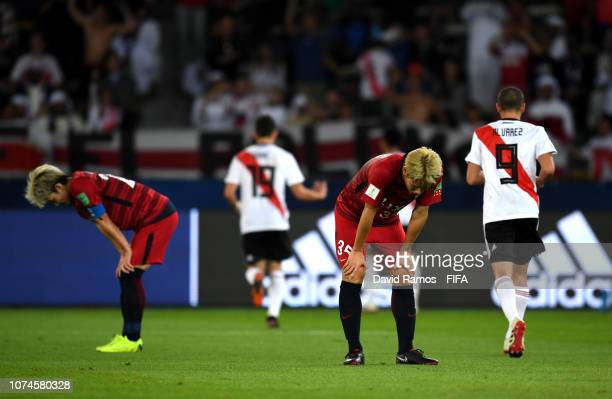 Daigo Nishi of Kashima Antlers and Yasushi Endo of Kashima Antlers react to River Plate scoring there fourth goal during the FIFA Club World Cup UAE...