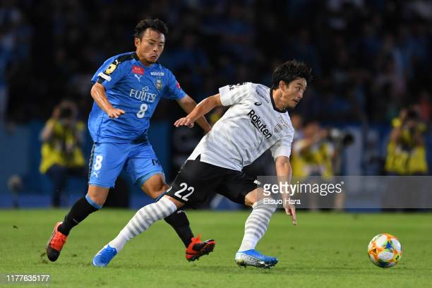 Daigo Nishi of Vissel Kobe and Hiroyuki Abe of Kawasaki Frontale compete for the ball during the JLeague J1 match between Kawasaki Frontale and...