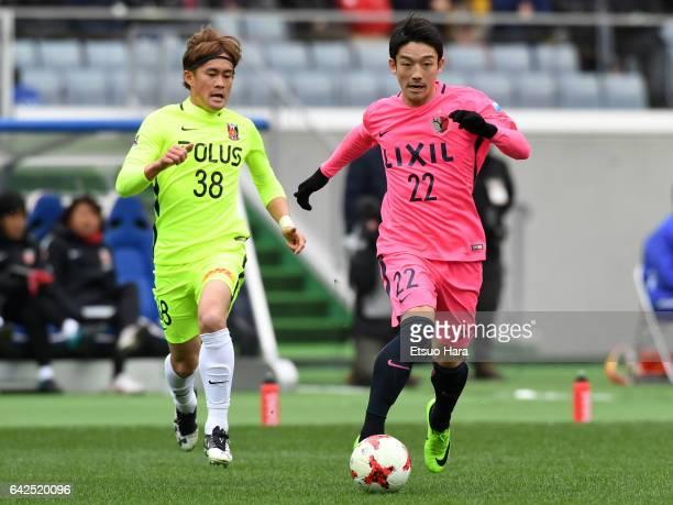 Daigo Nishi#22 of Kashima Antlers and Daisuke Kikuchi#38 of Urawa Red Diamonds compete for the ball during the Xerox Super Cup match between Kashima...
